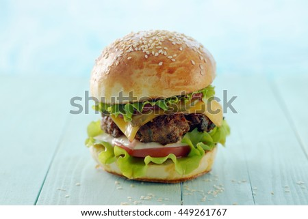 A classic hamburger on a light blue background.
