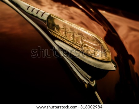 A classic hood ornament on a 1940's era American automobile. - stock photo