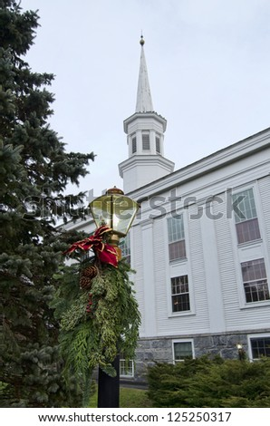 A classic New England church decorated for the holidays