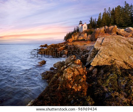 A Classic New England Lighthouse, The Bass Harbor Head Light In The First Light Of Dawn, Acadia National Park, Maine, USA - stock photo