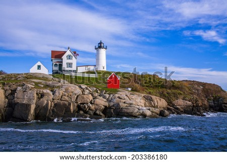 A Classic New England Lighthouse, The Nubble Light In The Afternoon At Cape Neddick, Maine, USA - stock photo