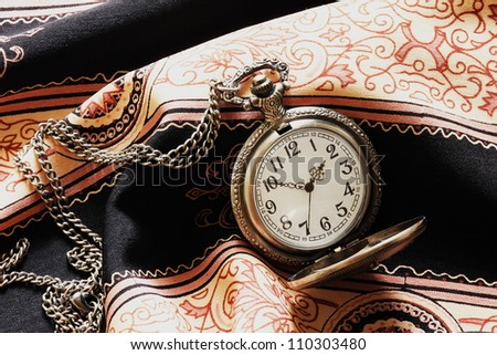 a classic pocket watch - stock photo