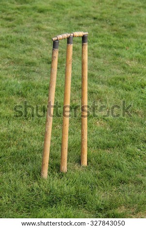 A Classic Set of Vintage Cricket Stumps and Bails. - stock photo