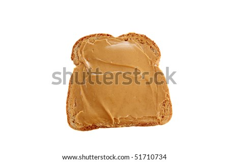 a classic slice of whole wheat bread with smooth peanut butter isolated on white - stock photo