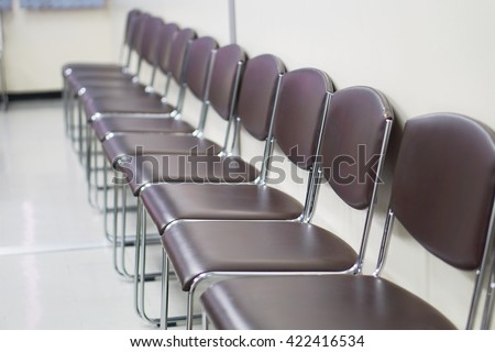 A classroom or presentation room in a modern university office. Black chairs,