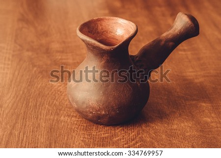 a clay pot designed specifically to make Turkish coffee