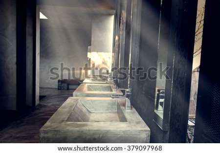 a clean new public toilet room empty, Commercial bathroom - vintage effect style pictures - stock photo