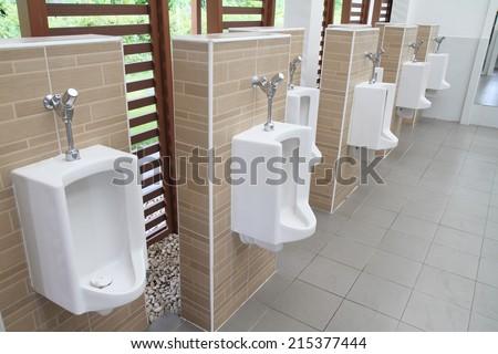 A clean public toilet room empty  - stock photo