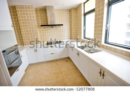 A Clean White Modern Kitchen. - stock photo