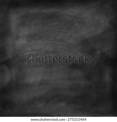 A cleaned blackboard. Wet sponge and chalk traces are visible. Background texture. - stock photo