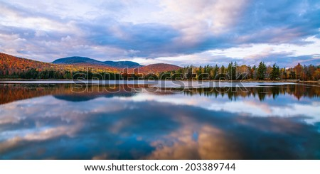 A Clear Colorful Reflection On An Autumn Evening At Loon Lake In The Adirondack Mountains Of New York State, USA - stock photo