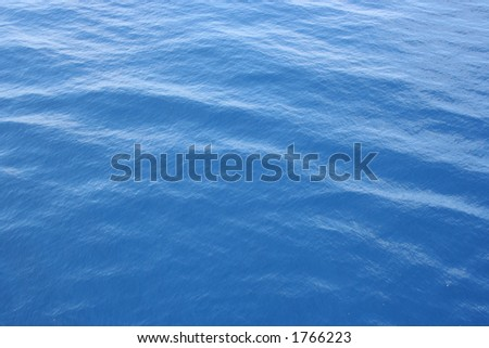 A clear shot of wide open ocean water. Great background picture. - stock photo