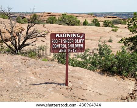 A cliff warning sign at Canyon de Chelly, Arizona, USA - stock photo