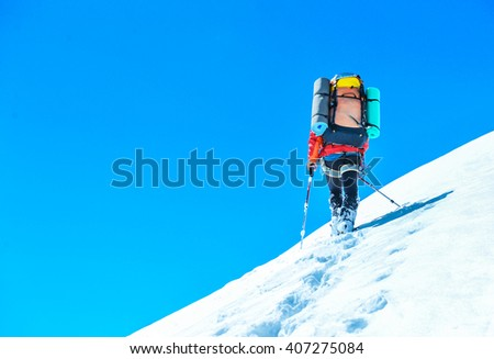 A climber reaching the summit of the mountain. Active sport conc - stock photo