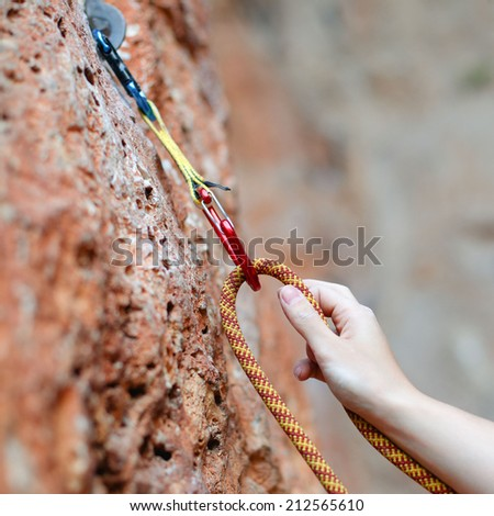 A climbers rope and quick-draws  - stock photo