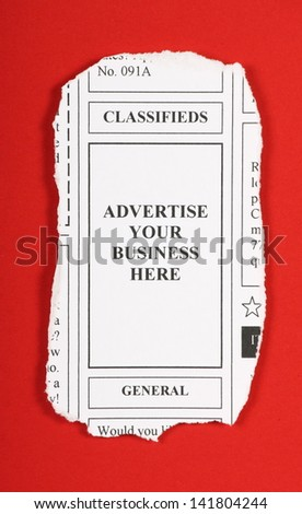 A clipping from the classified ads section of a newspaper offering advertisement space as part of your marketing strategy - stock photo