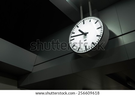 A clock at a train station - stock photo