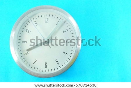 A clock isolated on the blue background