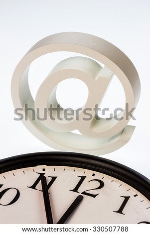 """a clock that """"11:55"""" shows and an e-mail logo: symbol photo for reform of data protection - stock photo"""