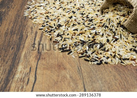 A close look to a bag dropped with a lot of rice. - stock photo
