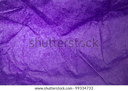 A close picture of a purple wrapping paper