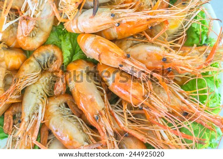 A close-up and selective focus spicy fried river prawns. Image has grain or blurry or noise and soft focus when view at full resolution. (Shallow DOF, slight motion blur)  - stock photo