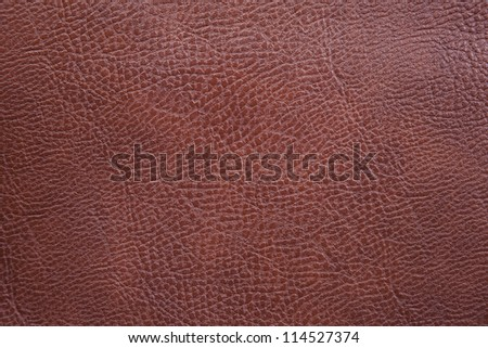 A close up background texture of brown leather. - stock photo