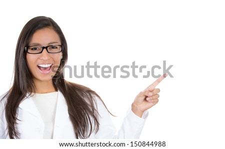 A close-up, cropped image of a smiling female doctor, pharmacist, dentist or ophthalmologist wearing glasses pointing at a copy space isolated on white background  - stock photo