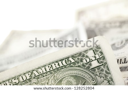A close-up cropped image of one dollar bill over the white background