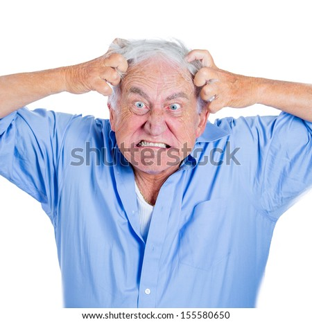 A close-up cropped portrait of an elderly, desperate, mad, looking crazy old man, going insane, pulling out his hair, isolated on a white background.Human emotions extremes. Loneliness, mental health - stock photo