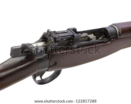 A close up image of brown rifle against white background