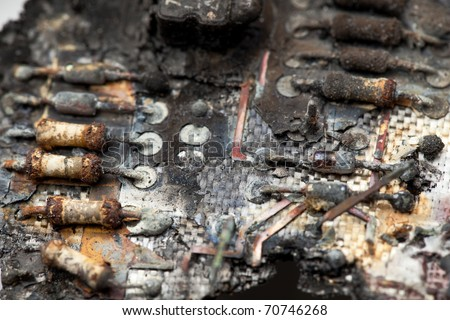 A close-up image of burnt components of a circuit board. / BURNT CIRCUIT 2 - stock photo