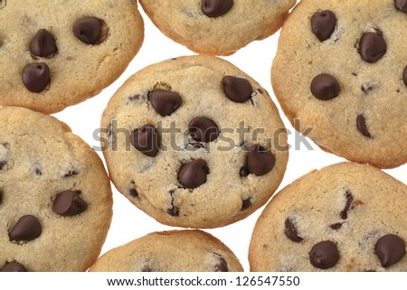 A close-up image of chocolate cookies with choco chips over the white background - stock photo