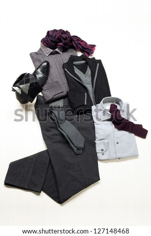 A close-up image of man's apparel folded on a white surface - stock photo