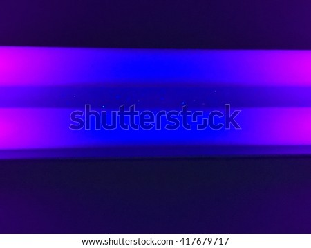 A close up look at two black light tubes.