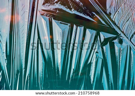A close up macro of a transparent thin frozen layer of ice.  - stock photo