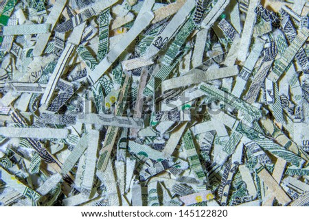 A close up macro of US currency shredded money - stock photo