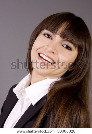 A close-up of a attractive business woman with bangs hair and smiling