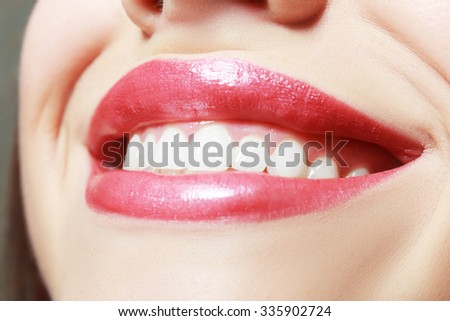 A close-up of a beautiful woman smile. - stock photo