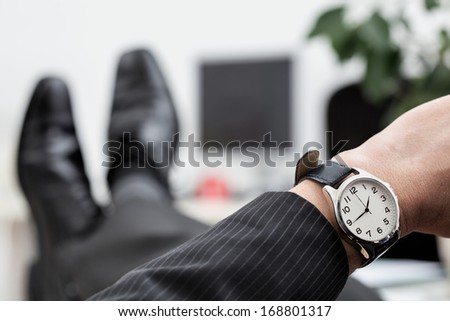 A close up of a businessman's elegant watch