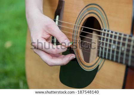 A close up of a classic guitar - stock photo
