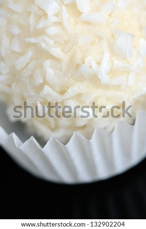 A close-up of a coconut sweet in a cupcake paper holder - stock photo