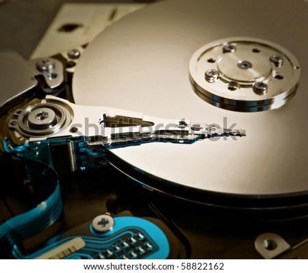 A close up of a computer hard disc - stock photo