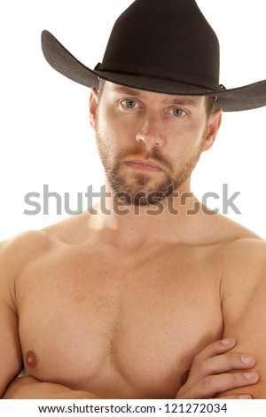 A close up of a cowboy's face and chest, while he is wearing his black cowboy hat. - stock photo