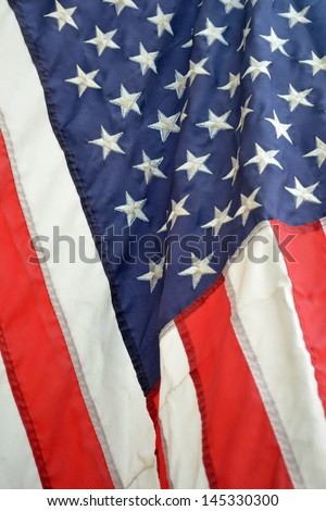A close up of a flag blowing in the breeze - stock photo