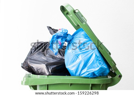 A close up of a full waste bin top - stock photo