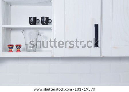 A close up of a furniture in new classic-look kitchen in modern rustic style in Krakow, Poland - stock photo