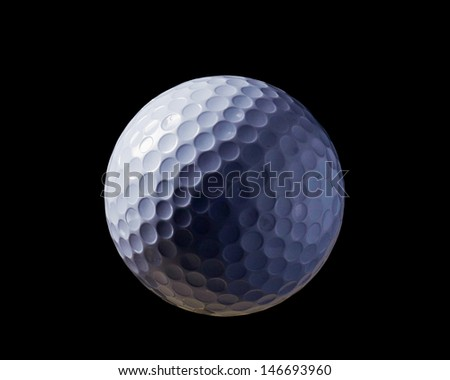 A close-up of a golf ball over dark background - stock photo