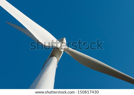 A close up of a large wind turbine in Portugal on a wind farm - stock photo