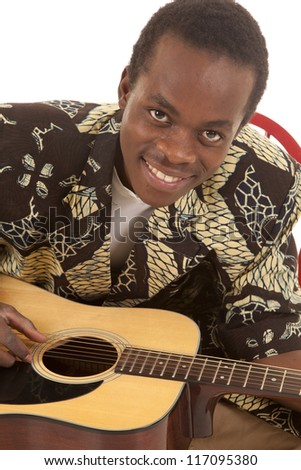 A close up of a man playing his guitar with  a  smile on his face.